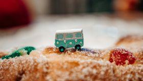 van figurine taveling by sugar cake