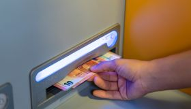 Woman Withdrawing Money On An ATM